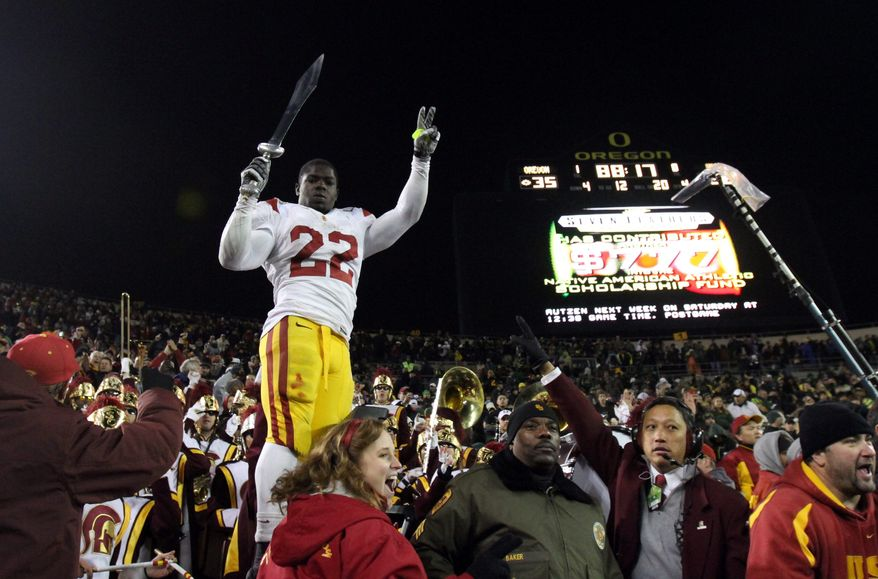Southern California may not be bowl-eligible because of NCAA sanctions, but that didn't stop Trojans fans from celebrating a 38-35 victory over Oregon on Saturday. (Associated Press)