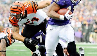 Baltimore running back Ray Rice runs past Cincinnati middle linebacker Dan Skuta during the second quarter for the first of his two touchdowns. Rice ran 20 times for 104 yards. (Associated Press)