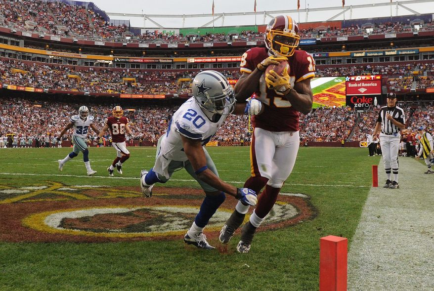 Donte Stallworth brought the Redskins even when he gathered in a 4-yard touchdown pass over Cowboys cornerback Alan Ball with 14 seconds left. (Andrew Harnik/The Washington Times)