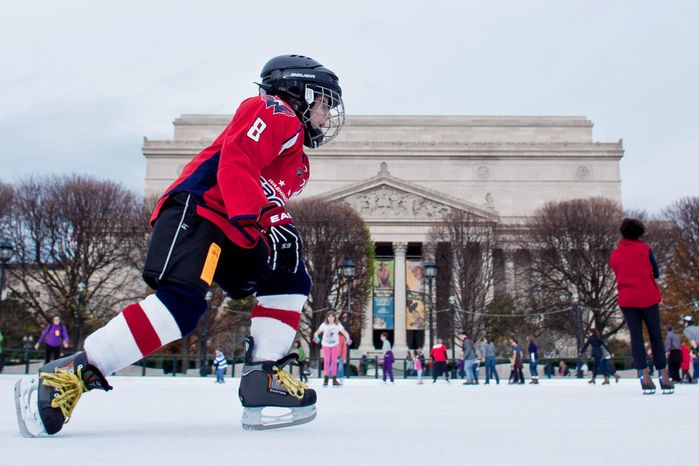 Lukas Jordana, 7, of Sterling, Va., confidently takes to the ice wearing his full Alex Ovechkin gear Sunday during the opening weekend of the rink at the National Gallery of Art Sculpture Garden. (T.J. Kirkpatrick / The Washington Times)
