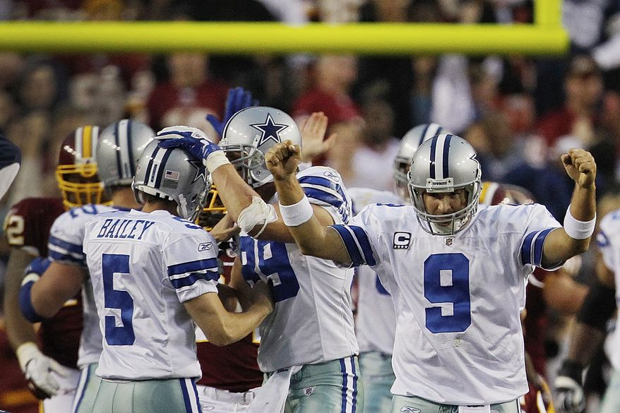 Dallas Cowboys quarterback Tony Romo reacts after Dan Bailey kicks the game-winning field goal during overtime against the Washington Redskins in Landover, Md., on Sunday, Nov. 20, 2011. The Cowboys won 27-24. (AP Photo/Pablo Martinez Monsivais)