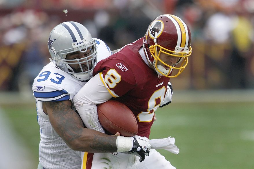 Dallas Cowboys outside linebacker Anthony Spencer tackles Washington Redskins quarterback Rex Grossman during the second half of an NFL football game against in Landover, Md., on Sunday, Nov. 20, 2011. (AP Photo/Evan Vucci)
