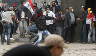 Protesters clash with Egyptian riot police in Tahrir Square in Cairo, Egypt, Sunday, Nov. 20, 2011. Firing tear gas and rubber bullets, Egyptian riot police on Sunday clashed for a second day with thousands of rock-throwing protesters. (AP Photo/Ahmed Ali)