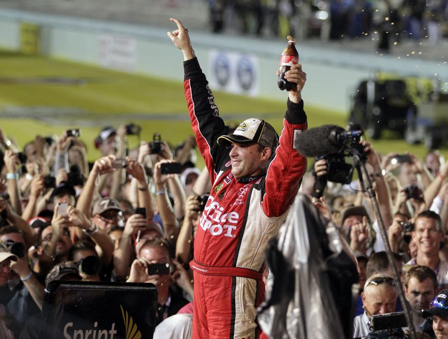 Tony Stewart celebrates after winning the NASCAR Sprint Cup Series auto race and clinching the series championship at Homestead-Miami Speedway in Homestead, Fla., Sunday, Nov. 20, 2011. (AP Photo/Chuck Burton)