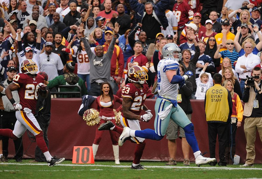 Dallas Cowboys tight end Jason Witten (82) runs past Washington Redskins cornerback DeAngelo Hall (23) to finish off a 59-yard touchdown during fourth quarter action at FedEx Field in Landover, Md., on Sunday, November 20, 2011. (Andrew Harnik/The Washington Times)