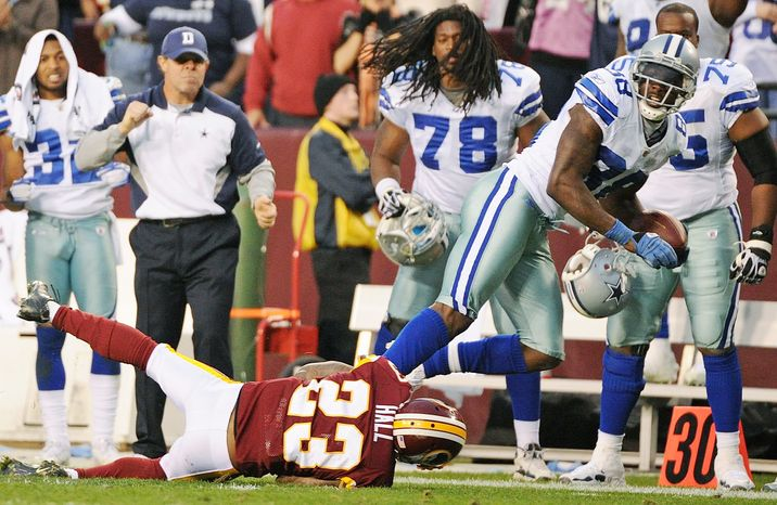 Dallas Cowboys wide receiver Dez Bryant (88) is taken down by Washington Redskins cornerback DeAngelo Hall (23) after a 26-yard reception that put the Cowboys in field goal position in overtime at FedEx Field in Landover, Md., on Sunday, November 20, 2011. (Andrew Harnik/The Washington Times)