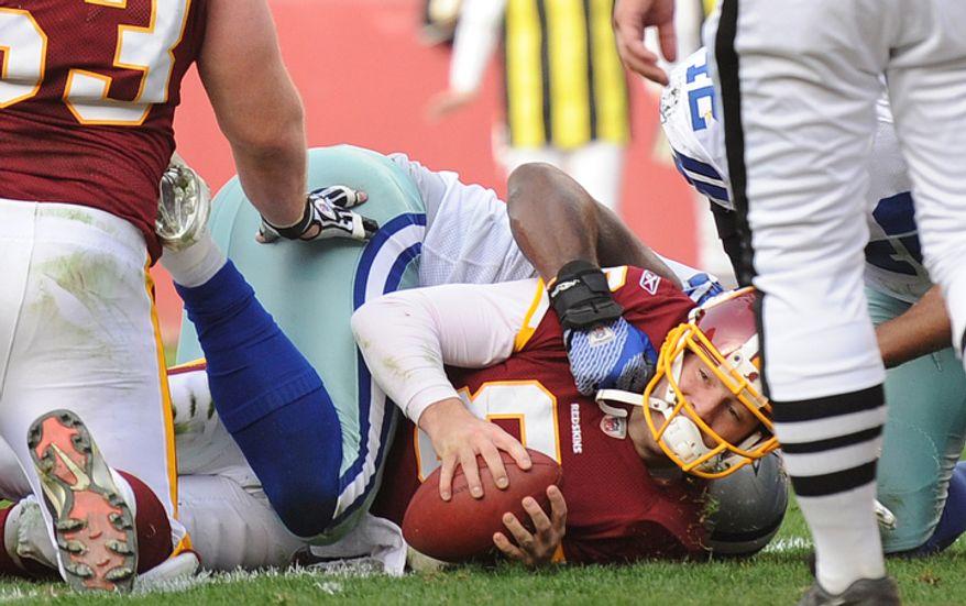 Washington Redskins quarterback Rex Grossman (8) scores on a 5-yard run during second quarter action. (Andrew Harnik/The Washington Times)
