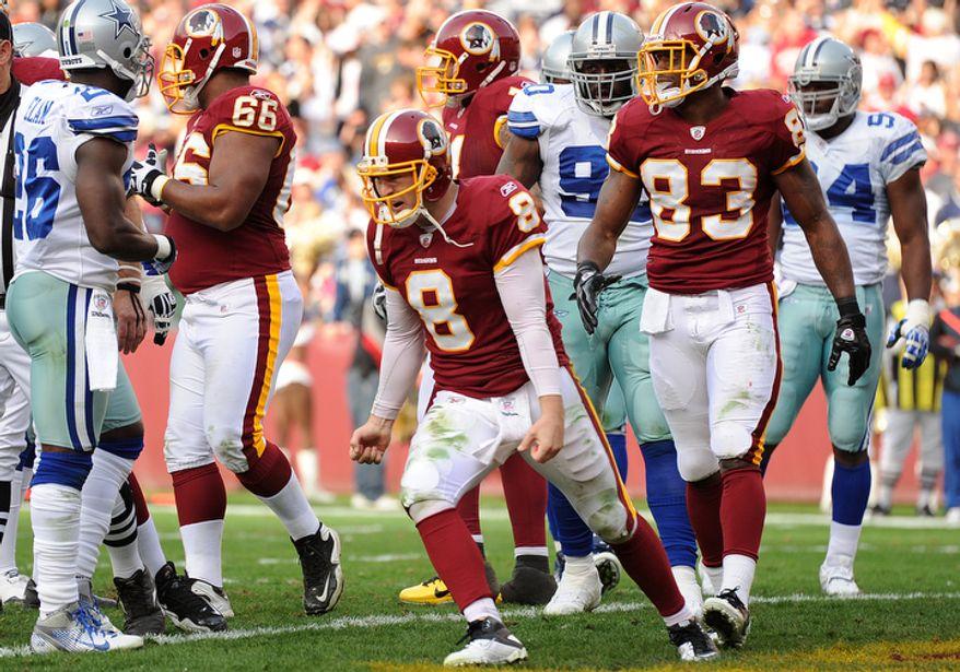 Washington Redskins quarterback Rex Grossman (8) celebrates after scoring on a 5-yard run during second quarter action. (Andrew Harnik/The Washington Times)