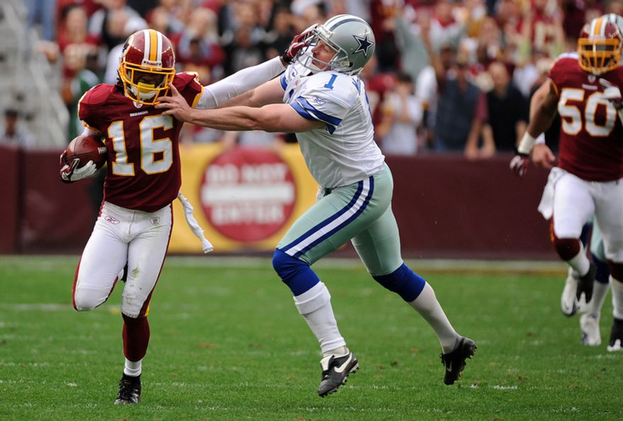 Washington Redskins wide receiver Brandon Banks (16) returns a third quarter punt 55 yards before being pushed out of bounds by Dallas Cowboys punter Mat McBriar (1). (Andrew Harnik/The Washington Times)