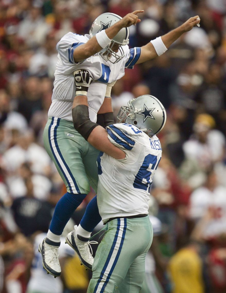 Quarterback Tony Romo (9) of the Dallas Cowboys celebrates with guard Kyle Kosier (63) after throwing a 59-yard touchdown pass to tight end Jason Witten during the fourth quarter of the game. (Pratik Shah/The Washington Times)