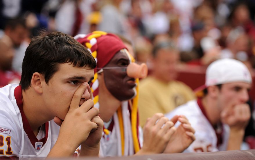 Redskins fans look on dejected after the Cowboys take the lead in the fourth quarter. (Andrew Harnik/The Washington Times)