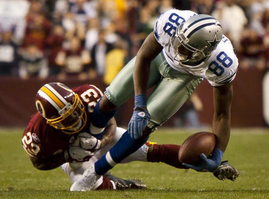 Wide Receiver Dez Bryant (88) of the Dallas Cowboys catches a pass against Cornerback DeAngelo Hall (23) of the Washington Redskins to put the Cowboys in field goal range during overtime. (Pratik Shah/The Washington Times)