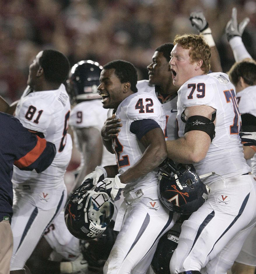 Virginia players celebrate their 14-13 victory over Florida State on Saturday, Nov. 19, 2011, in Tallahassee, Fla.(AP Photo/Steve Cannon)