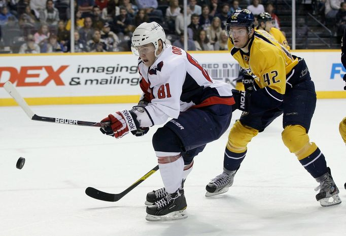 **FILE** Defenseman Dmitry Orlov (left) had two goals and seven assists in 19 games with Hershey in 2010-11. (Associated Press)