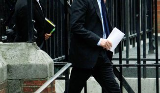 """British actor Hugh Grant arrives to testify at Britain's media ethics probe that was set up in the wake of the scandal about phone hacking at Rupert Murdoch's News of the World. """"There has been a section of our press that has been allowed to become toxic over the past 20 or 30 years,"""" he said. (Associated Press)"""