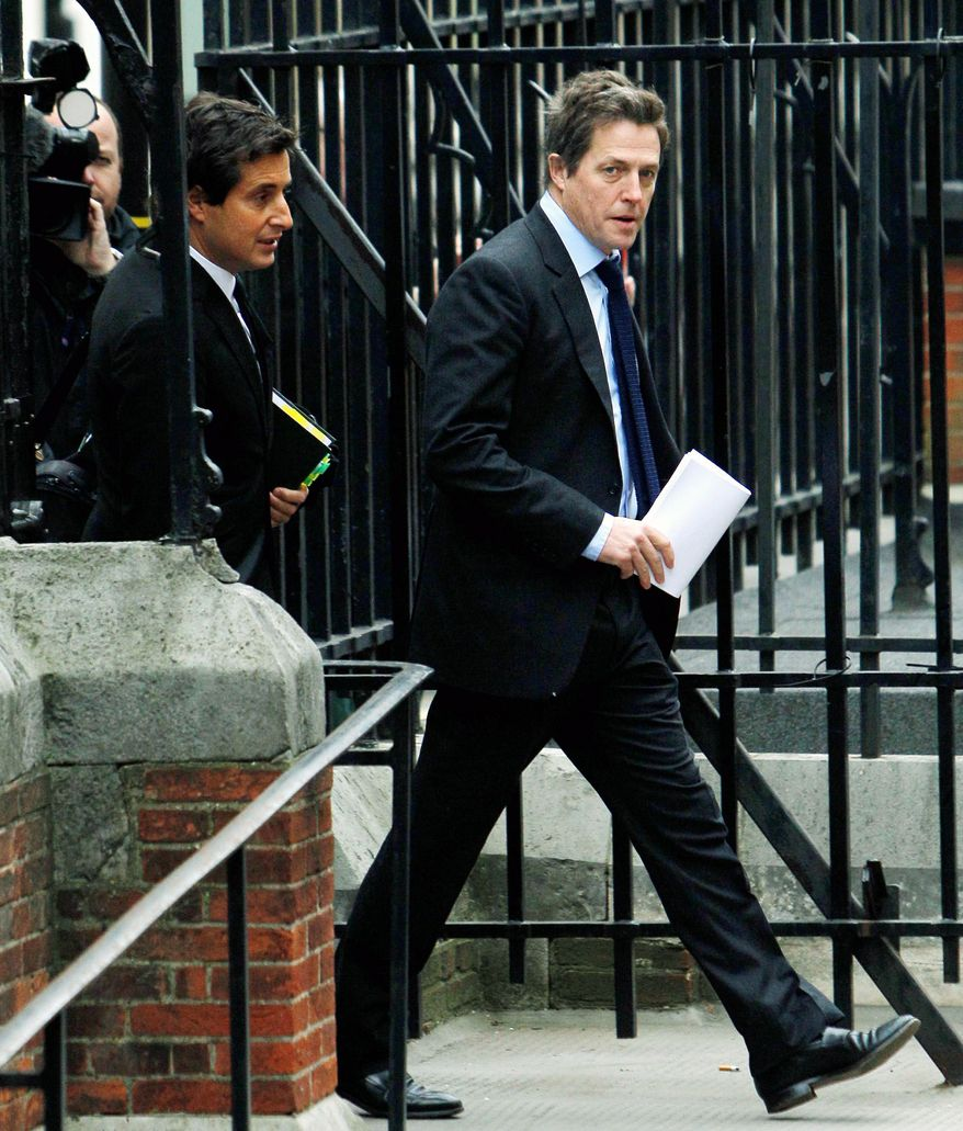 "British actor Hugh Grant arrives to testify at Britain's media ethics probe that was set up in the wake of the scandal about phone hacking at Rupert Murdoch's News of the World. ""There has been a section of our press that has been allowed to become toxic over the past 20 or 30 years,"" he said. (Associated Press)"