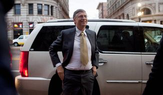 Microsoft founder Bill Gates arrives at the federal courthouse Monday in Salt Lake City, where he testified in a $1 billion antitrust lawsuit brought by Novell. Mr. Gates said Novell just couldn't deliver a Windows 95-compatible WordPerfect program in time for its rollout. (Associated Press)