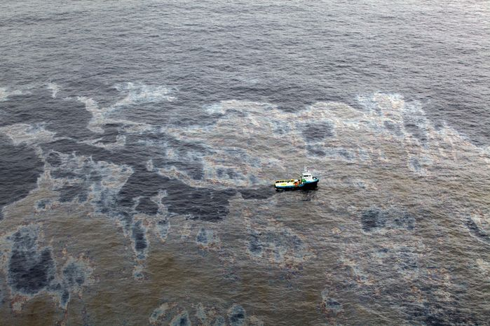 An aerial view shows a boat crossing an area of the oil spill in an offshore field operated by Chevron at the Bacia de Campos in Rio de Janeiro.  (Associated Press)