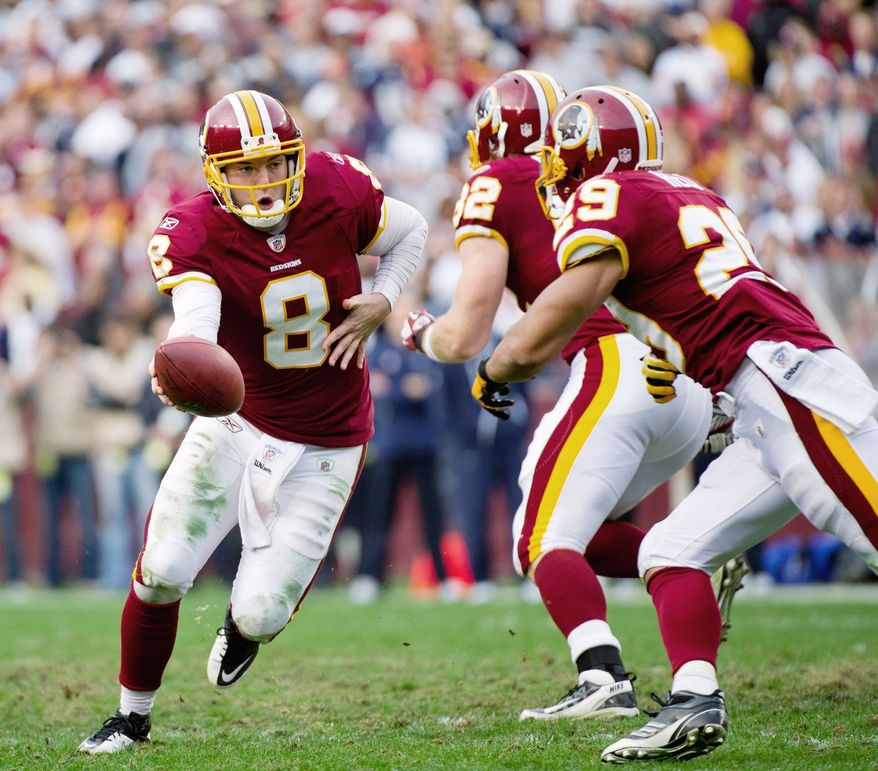 Rex Grossman (left) had a 65.8 completion percentage in Sunday's loss to Dallas. It was his highest mark since completing 71.4 percent for Chicago in Super Bowl XLI on Feb. 4, 2007. (Andrew Harnik/The Washington Times)