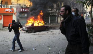 Protesters move away from tear gas fired by Egyptian riot police during clashes near Tahrir Square in Cairo on Nov. 21, 2011. (Associated Press)
