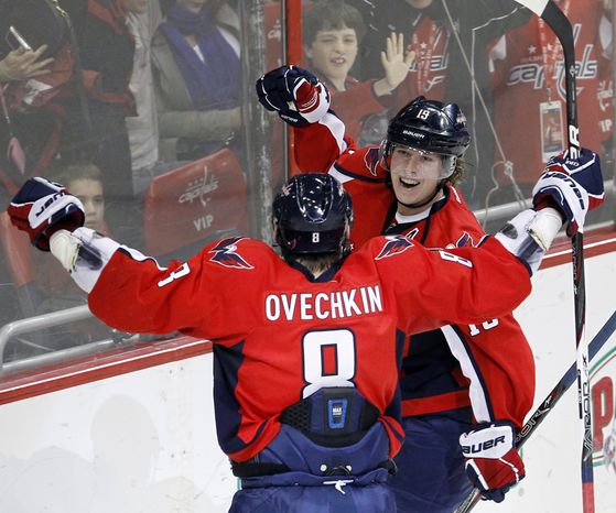 ** FILE ** Washington Capitals center Nicklas Backstrom celebrates with left wing Alex Ovechkin (8) after Backstrom scored on Phoenix Coyotes goalie Jason LaBarbera during the third period of an NHL game in Washington on Monday, Nov. 21, 2011. The Capitals won 4-3. (AP Photo/Ann Heisenfelt)