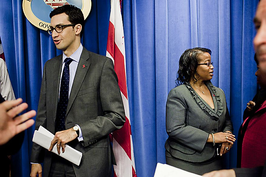 Pedro Ribeiro, Mayor Vincent Gray's new head of communications, left, and Sheila Bunn, the mayor's new deputy chief of staff, replacing Linda Wharton-Boyd, who was moved to the District's Department of Health, talks with the press following a press conference at the mayor's office in Washington, D.C. on Nov. 21, 2011.