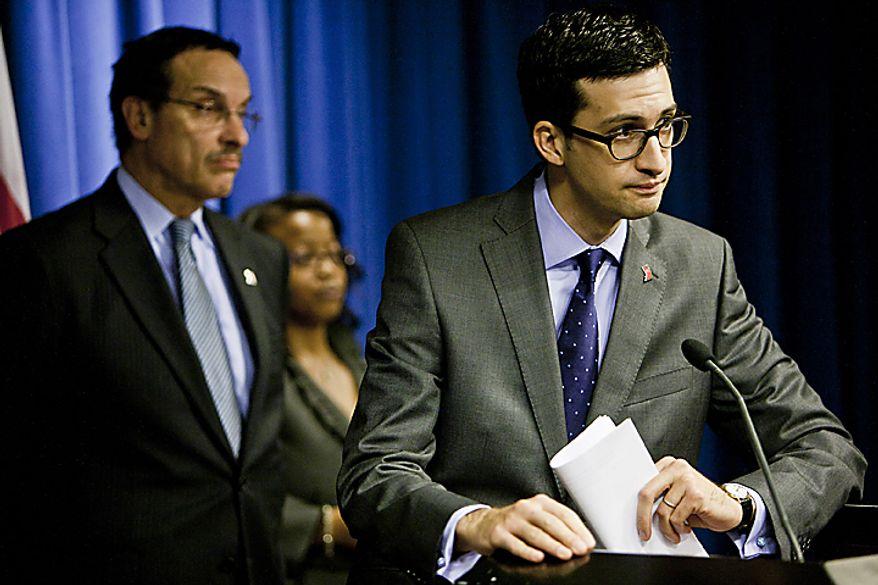 Pedro Ribeiro, Mayor Vincent Gray's new head of communications, right, speaks at a press conference with Mayor Gray, from left, and Sheila Bunn, the mayor's new deputy chief of staff, replacing Linda Wharton-Boyd, who was moved to the District's Department of Health, at the mayor's office in Washington, D.C. on Nov. 21, 2011.(T.J. Kirkpatrick/ The Washington Times)