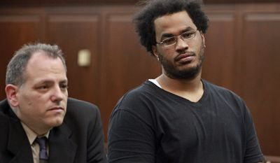 """Jose Pimentel (right), 27, represented by attorney Joseph Zablocki (left), is arraigned at Manhattan criminal court in New York on Nov. 20, 2011. Pimentel, an """"al Qaeda sympathizer"""" accused of plotting to bomb police and post offices in New York City as well as U.S. troops returning home, was charged with criminal possession of explosive devices with the intent to use in a terrorist manner. (Associated Press)"""