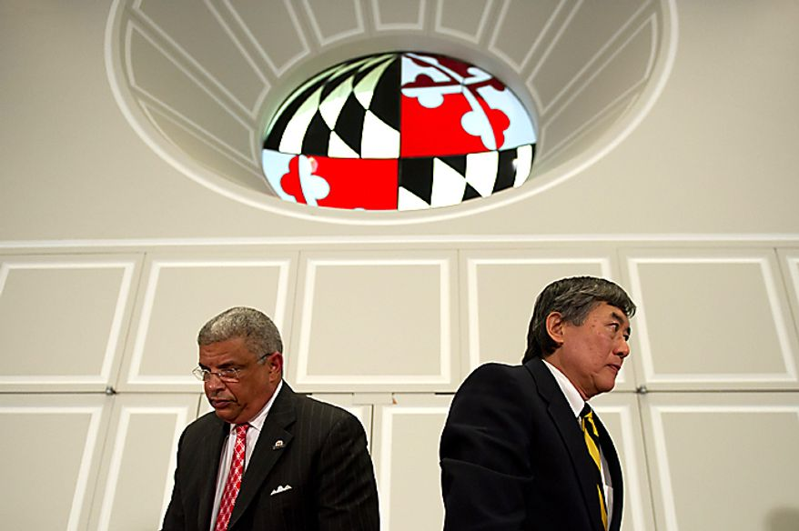 University of Maryland athletic director Kevin Anderson (left) and UM President Wallace D. Loh announce Nov. 21, 2012, at a press conference on the campus that the university will cut eight sports teams on July 1 if they cannot raise private funds. (Andrew Harnik/The Washington Times)