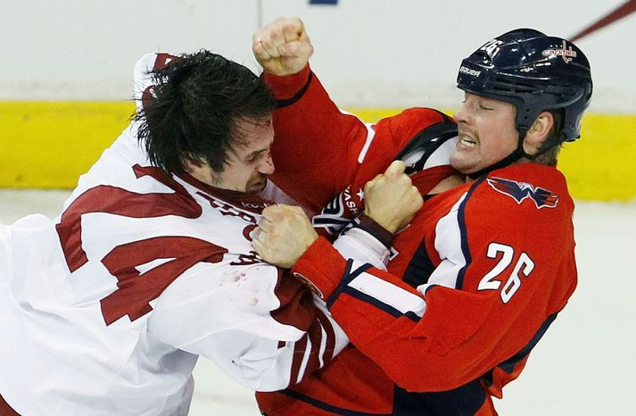Capitals left wing Matt Hendricks (right) trades blows with Coyotes center Kyle Chipchura during Washington's 4-3 win over Phoenix on Monday. The Capitals had lost their previous four games. (Associated Press)