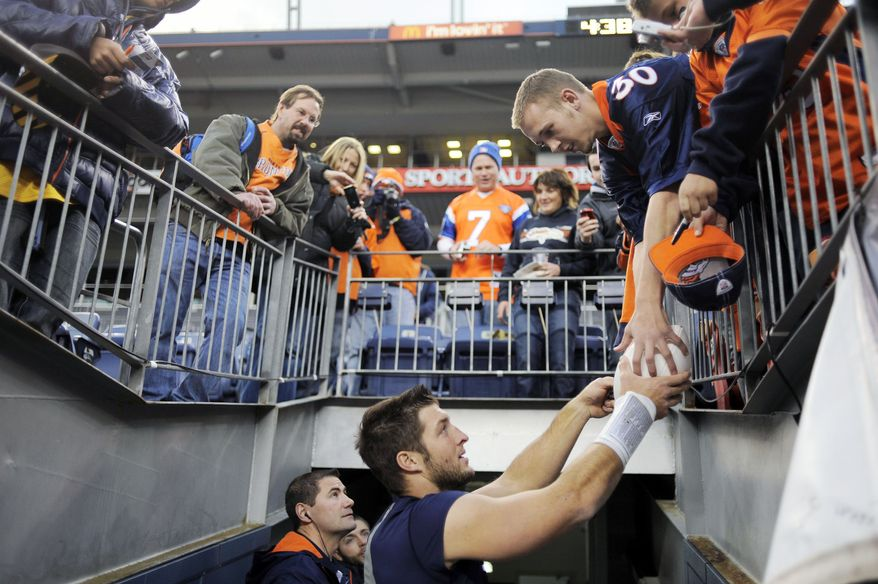 Denver Broncos quarterback Tim Tebow has developed into one of the most polarizing figures in American sports because of his upbeat, do-gooder personality and unconventional playing style. (Denver Post via Associated Press)