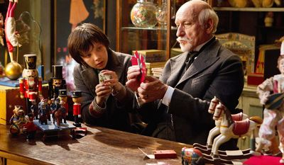 """Asa Butterfield (left) as Hugo Cabret and Ben Kingsley as Georges Melies bond over their obsession with innovation in the new Martin Scorsese 3-D movie """"Hugo,"""" which celebrates Frenchman Melies' life as a filmmaker. (Paramount Pictures via Associated Press)"""
