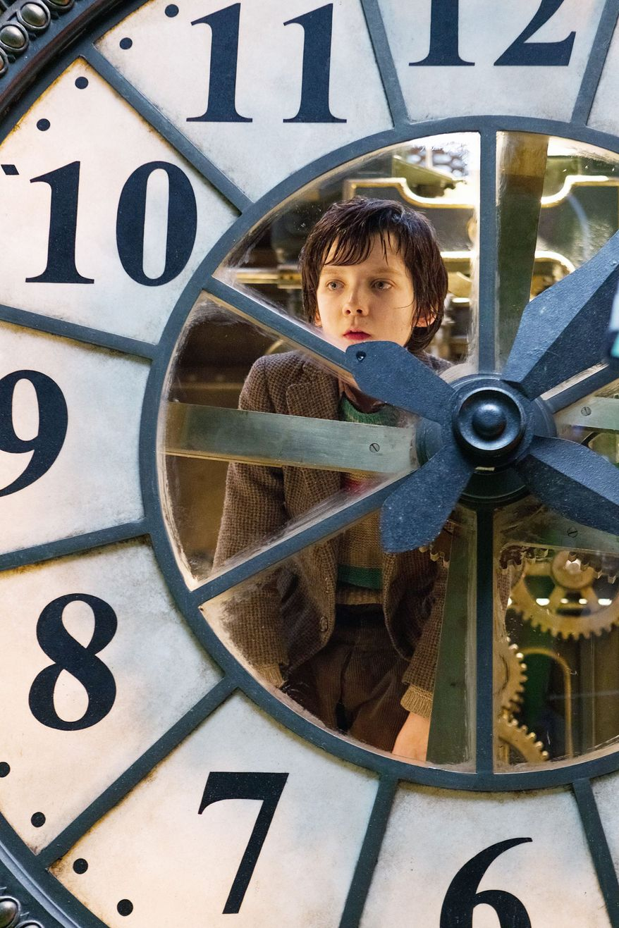 """Asa Butterfield portrays Hugo Cabret in """"Hugo."""" The movie, Martin Scorsese's first directing effort in 3-D, tells the story of an orphaned boy who maintains clocks in a train terminal. (Paramount Pictures via Associated Press)"""