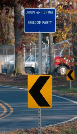 """An Adopt-A-Highway sign at the intersection of Ward and Cedar Grove roads west of Lewes, Del., is one of two that give sponsorship credit to the Freedom Party, which is a neo-Nazi group that tried but failed to get the name """"Nazi Party"""" on the signs. (News Journal)"""