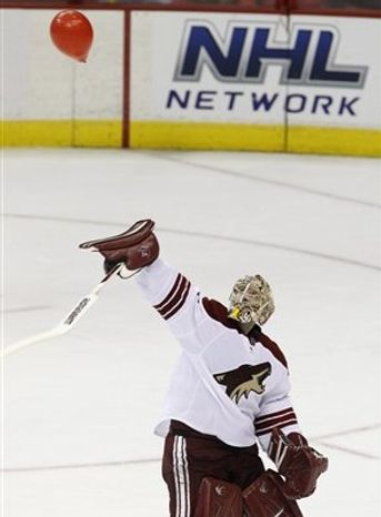 Jason LaBarbera tries to swat down red ballon during second period. (Associated Press)