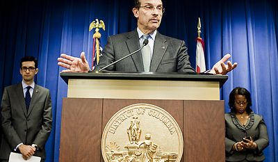 D.C. Mayor Vincent Gray, at center, announces the appointment of Pedro Ribeiro, left, to the mayor's head of communications and Sheila Bunn to deputy chief of staff, replacing Linda Wharton-Boyd, who was moved to the District's Department of Health, during a press conference. (T.J. Kirkpatrick/ The Washington Times)