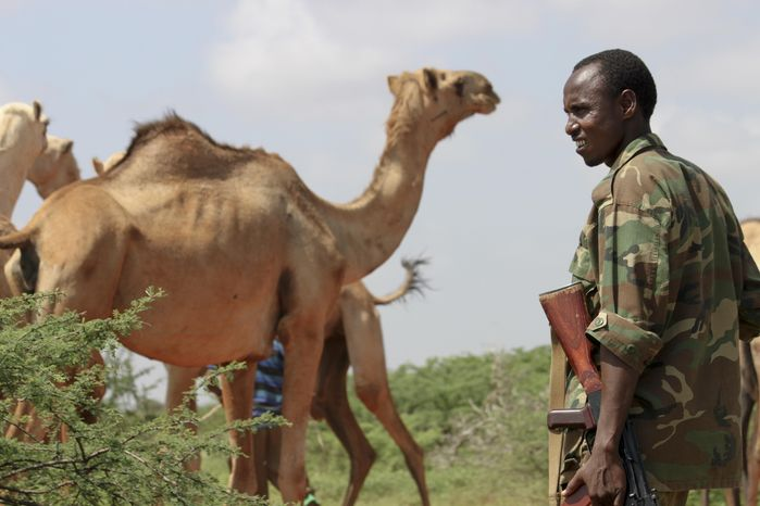 In this photo taken Monday, Nov. 21, 2011, a Somali government soldier provides security for visiting media near Dolo in Somalia. (AP Photo/Jason Straziuso)