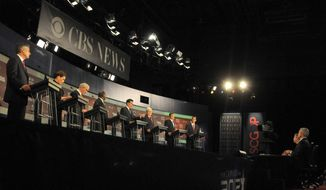 **FILE** Republican presidential candidates (from left) former Utah Gov. Jon Huntsman, Rep. Michele Bachmann of Minnesota, Rep. Ron Paul of Texas, businessman Herman Cain, Former Massachusetts Gov. Mitt Romney, former House Speaker Newt Gingrich, Texas Gov. Rick Perry, and former Pennsylvania Sen. Rick Santorum prepare Nov. 12, 2011, before the CBS News/National Journal foreign policy debate in Spartanburg, S.C. (Associated Press)