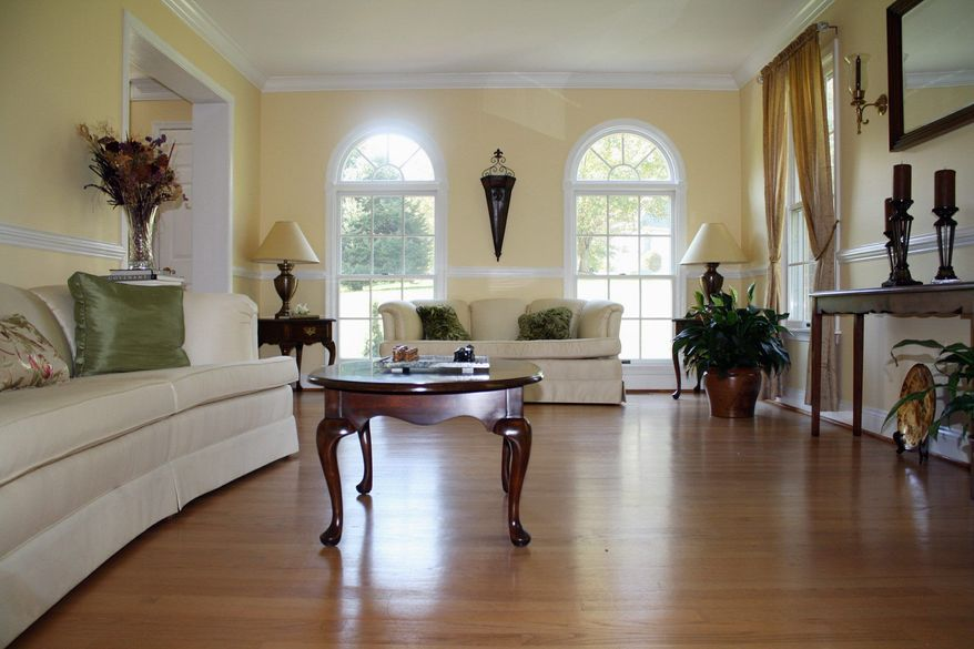 The formal living room is painted a cheerful pale yellow.