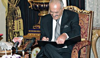 Yemeni President Ali Abdullah Saleh, in Riyadh, Saudi Arabia, signs an agreement to step down on Wednesday, Nov. 23, 2011. (Associated Press)