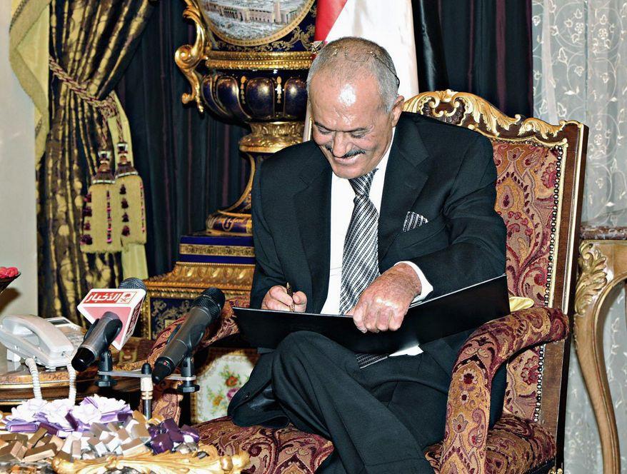 Yemeni President Ali Abdullah Saleh, in Riyadh, Saudi Arabia, signs an agreement to step down on Wednesday, Nov. 23, 2011. (Associated Press)