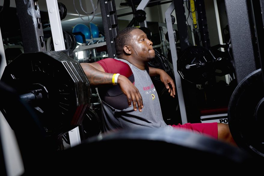 Washington Redskins rookie defensive end Jarvis Jenkins lifts weights at Redskins Park in Ashburn, Va., as part of his rehabilitation from a torn ACL. Jenkins promises his injured right knee will be stronger than ever by the time the 2012 season rolls around. (Andrew Harnik/The Washington Times)