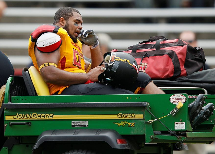 Maryland defensive lineman Andre Monroe, shown after injuring an ankle Sept. 24, is one of only three Maryland freshmen to record five sacks since 2001. (Associated Press)