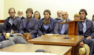 **FILE** From left: Johnny Mullet, Lester Mullet, Daniel Mullet, Levi Miller and Eli Miller wait Oct. 19, 2011, to make their pleas in Holmes County Municipal Court in Millersburg, Ohio. The five men, along with reputed Amish breakaway sect leader Sam Mullet and Emanuel Shrock, were arrested Nov. 23, 2011, by the FBI and local sheriff's deputies on federal hate crime charges. (Associated Press/Wooster Daily Record)