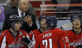 ** FILE ** Washington Capitals head coach Bruce Boudreau talks with center Brooks Laich during the third period against the Phoenix Coyotes in Washington on Monday, Nov. 21, 2011. The Capitals won 4-3. (AP Photo/Ann Heisenfelt, File)