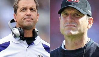 ** FILE ** Brothers John and Jim Harbaugh will battle each other when the Baltimore Ravens take on the San Francisco 49ers at the Super Bowl. (Associated Press)