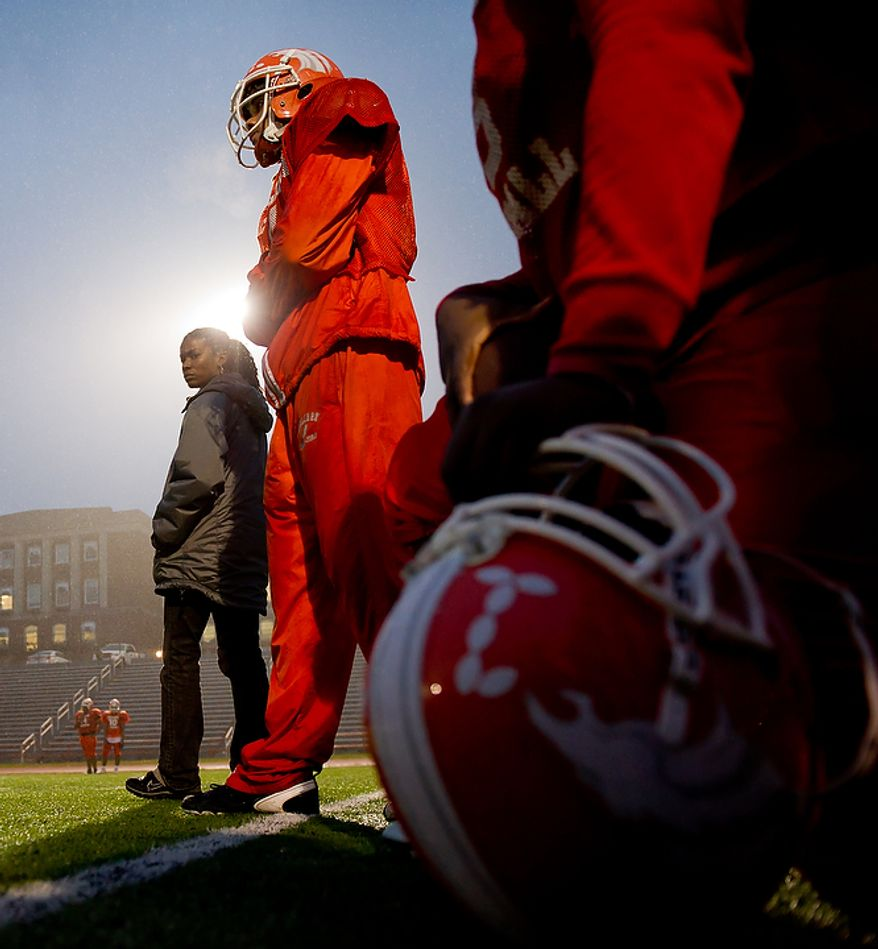 Coolidge High School Football Coach Natalie Randolph, left, gets her team ready for the Turkey Bowl, Washington, DC, Monday, November 21, 2011. (Andrew Harnik/The Washington Times)