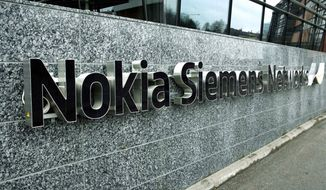 ** FILE ** Telecommunications services company Nokia Siemens Networks company offices in Tampere, Finland, in this file photo dated April 6, 2008. It is announced Wednesday, Nov. 23, 2011, that the Finnish-German telecommunications company Nokia Siemans Networks is planning to cut about 17,000 employees by the end of 2013. (AP Photo/LEHTIKUVA, Timo Jaakonaho)