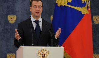 Russian President Dmitry Medvedev speaks at an award ceremony in the Gorki residence outside Moscow, Tuesday, Nov. 22, 2011. (AP Photo/Alexander Nemenov, Pool)