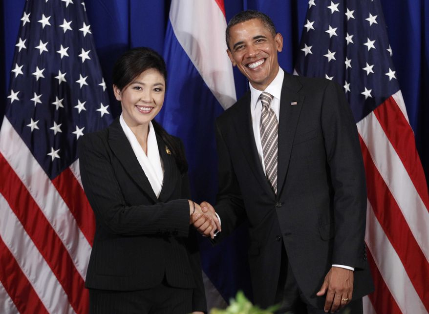 ** FILE ** U.S. President Barack Obama meets with Thai Prime Minister Yingluck Shinawatra on the sidelines of the East Asia Summit in Nusa Dua, on the island of Bali, Indonesia, Saturday, Nov. 19, 2011. (AP Photo/Charles Dharapak)